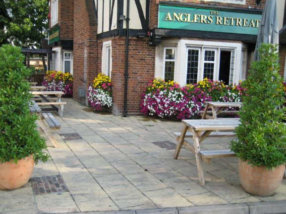 Pressure wash on patio of pub in Staines