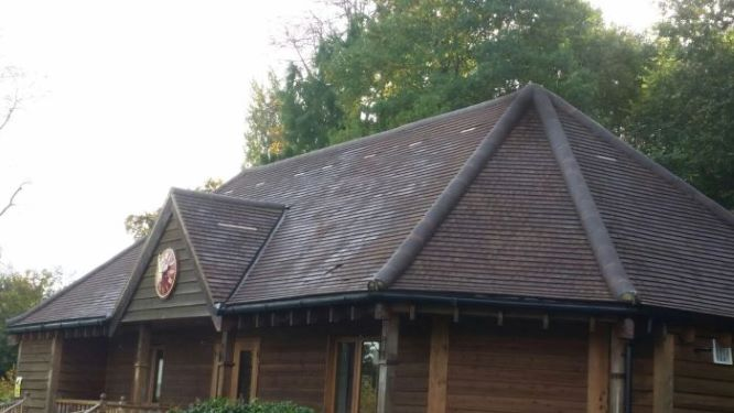 Before pressure washing a roof on a commercial property in Surrey.