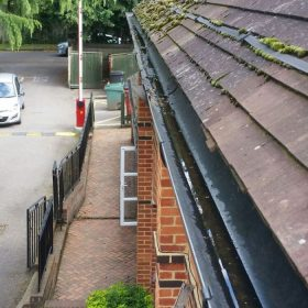 Gutter on a commercial property in Surrey after cleaning