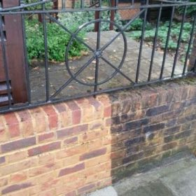 Before pressure washing main entrance wall in Teddington, Surrey