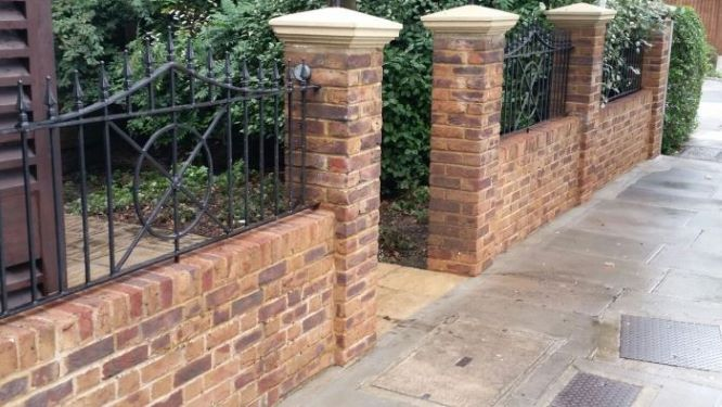 After pressure washing main entrance wall in Teddington, Surrey
