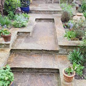 Before pressure washing garden steps
