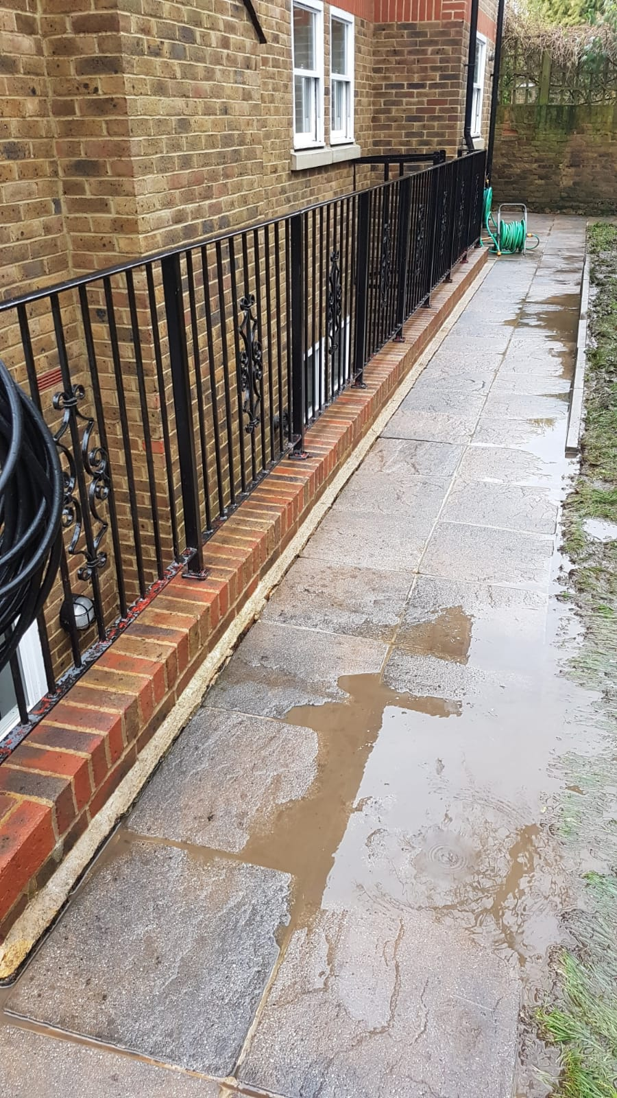 After pressure washing patio and wall