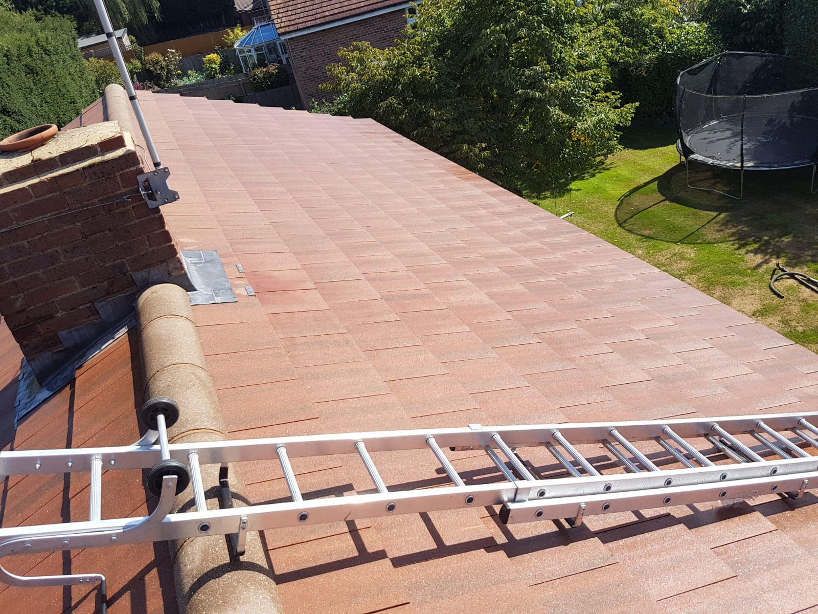 Pressure washing on a roof